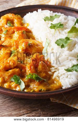 Shrimps In Curry Sauce With Rice And Cilantro Vertical