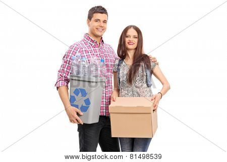 Couple holding a box and a recycle bin isolated on white background