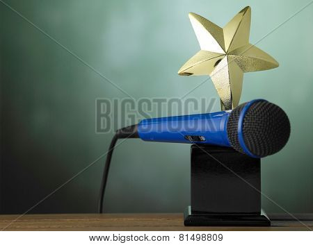 star shape trophy and microphone