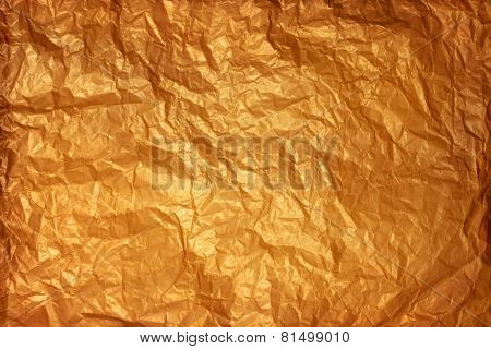 Old crumpled paper texture of warm colors.