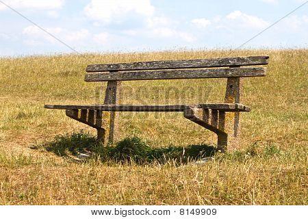Wooden Bench On Hillside