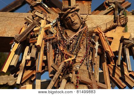 SIAULIAI, LITHUANIA - AUGUST 1, 2013: Wooden Crucifix at the Hill of Crosses, the most important Lithuanian Catholic pilgrimage site located near the town of Siauliai in Northern Lithuania.