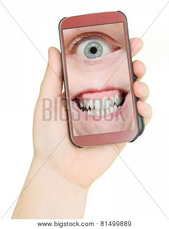 Mobile phone with eye and teeth. Big Brother is watching you. Internet safety concept.