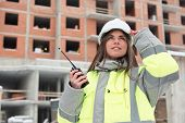stock photo of inspection  - Civil Engineer at at construction site is inspecting ongoing production  - JPG