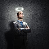 image of halo  - Young handsome businessman with halo above head - JPG