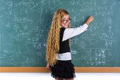 image of clever  - Clever nerd pupil blond girl writing in green board student schoolgirl - JPG