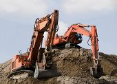 foto of earth-mover  - Excavators during earth moving works at construction site - JPG