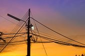 picture of nuclear family  - Electricity power lines with light at twilight - JPG