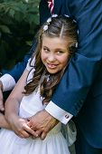 picture of communion  - Little Girl in her First Communion Day with Her Father - JPG