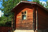 pic of wooden shack  - Wooden house gardening in the summer day - JPG