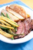 picture of flank steak  - grilled flank steak done rare with potato wedges and garlic fried string beans
