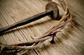 stock photo of thorns  - a depiction of the crown of thorns of Jesus Christ with blood and a nail on the Holy Cross - JPG