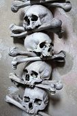 image of skull cross bones  - Decoration made of human bones and skulls in the Sedlec Ossuary near Kutna Hora - JPG