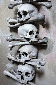 stock photo of skull cross bones  - Decoration made of human bones and skulls in the Sedlec Ossuary near Kutna Hora - JPG