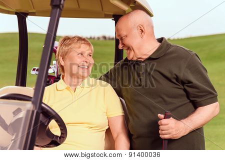 Senior man standing near his wife in cart