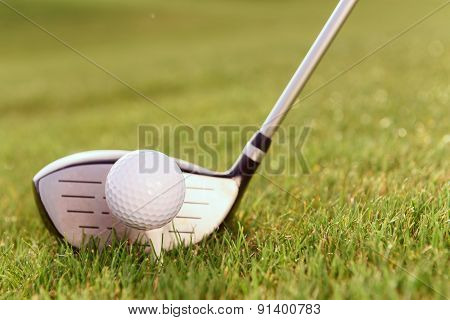 Golf club and ball on tee
