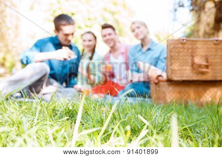 Young people during on background of green grass