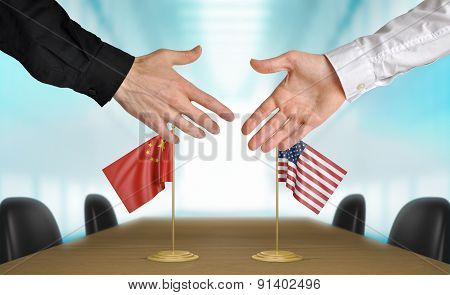 China and United States diplomats agreeing on a deal
