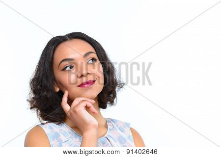 Thoughtful mulatto girl on isolated white background
