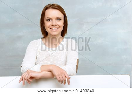 Smiling girl leaning on her elbows