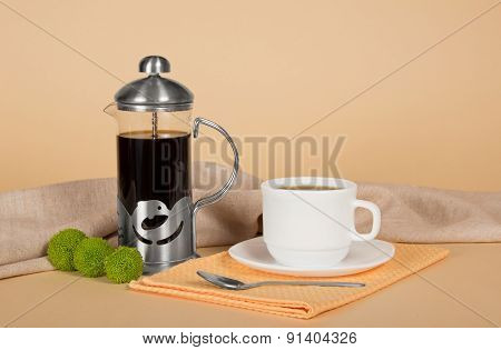Coffee pot, cup with coffee