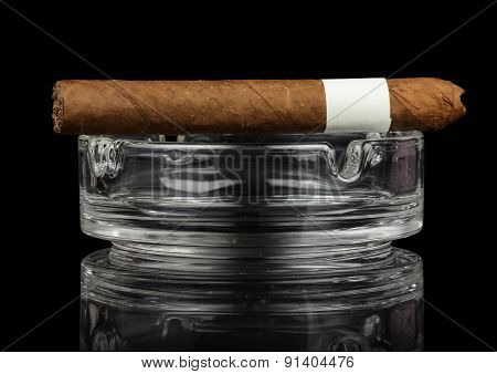 Smoking cigar in an ashtray