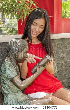 Little Girl With Bronze Sculptures