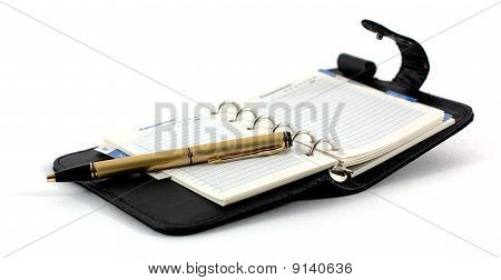 The Opened Pad And The Pen On A White Background