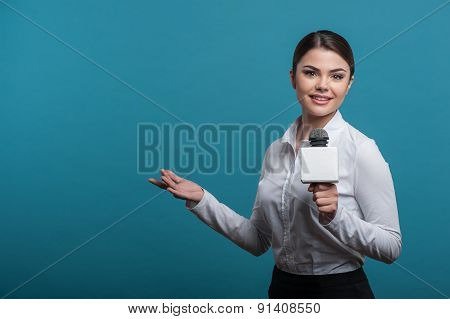 Beautiful girl TV journalist with pretty smile is reporting