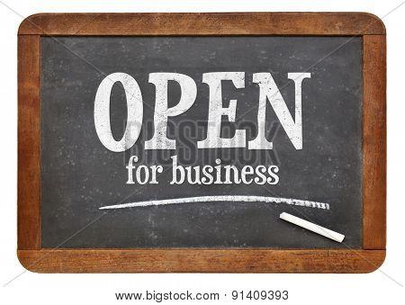 open for business sign on  a vintage slate blackboard