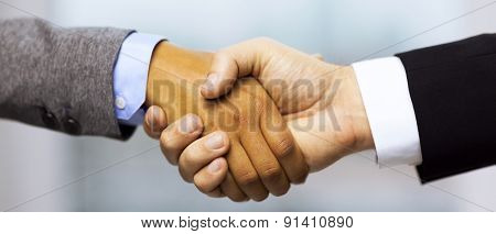 business and office concept - businessman and businesswoman showing shaking hands in office
