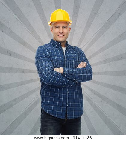 repair, construction, building, people and maintenance concept - smiling male builder or manual worker in helmet over gray burst rays background