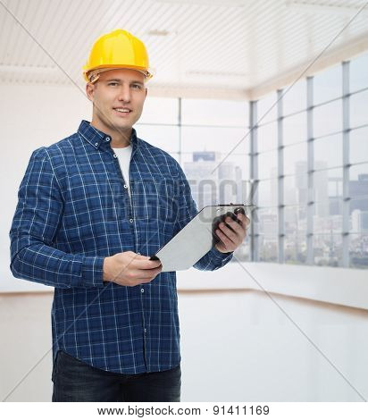 repair, construction, building, people and maintenance concept - smiling male builder or manual worker in helmet with clipboard over empty flat background