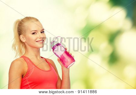 sport, exercise and healthcare - sporty woman with water bottle
