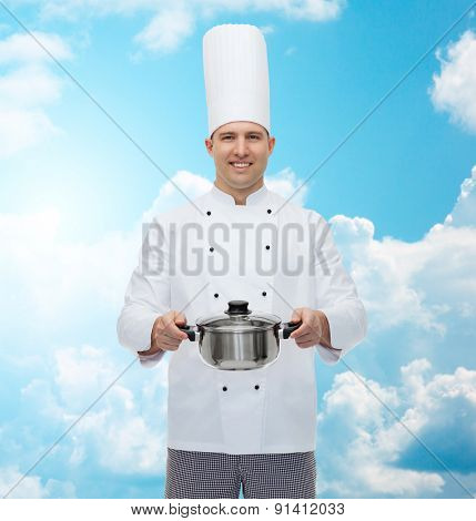 cooking, profession and people concept - happy male chef cook holding pot over blue sky with clouds background