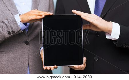 business, technology, internet and office concept - businessman and businesswoman with blank black tablet pc screen in office