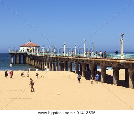 People Enjoy The Beach At The Manhattan Beach Pier