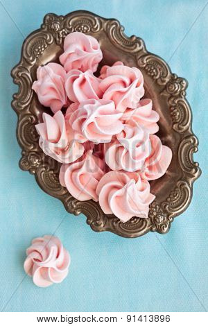 Pink Meringue On Plate On Blue Background, Top View