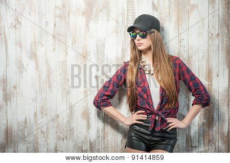 Pretty hipster woman with hat and glasses