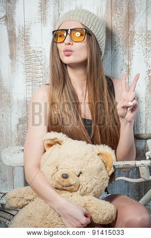 Pretty hipster woman with glasses and toy