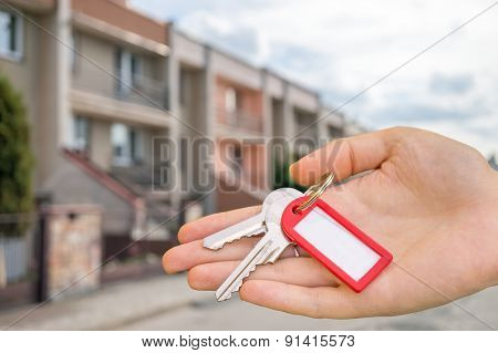 Real Estate Agency Sells House And Holds Keys In Hand