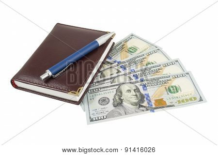 Notebook, Pen And Dollars