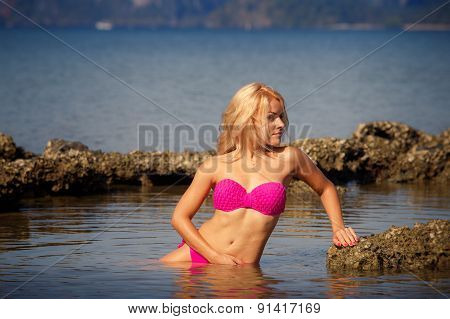 Blonde In Swimsuit Side-view Half In Sea