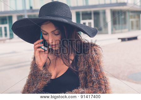 Beautiful Girl Talking On Phone In An Urban Context