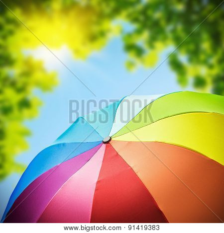 Rainbow Umbrellas Against The Backdrop Of Nature