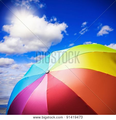 Colorful Umbrella Against The Sky With The Sun
