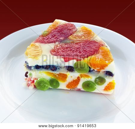 Piece Of A Colorful Jelly Cake With Fruits