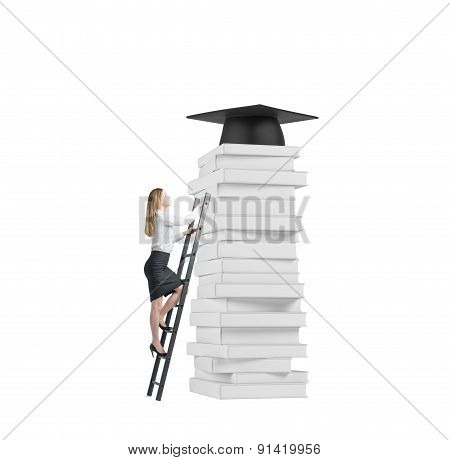 Young Lady Is Climbing Up To Get University Degree. Pile Of Book And A Graduation Hat As A Prize. I