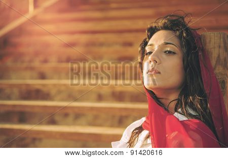 Mediterranean Young Girl Sitting On Stairs Warm Effect Applied