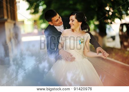 Happy Wedding Couple Embrace